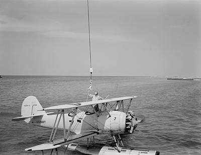 Naval Aircraft Photograph - A U.s. Navy N3n Seaplane Being Attached by Stocktrek Images
