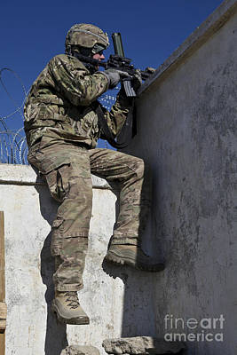 Logar Photograph - A U.s. Soldier Provides Security At An by Stocktrek Images