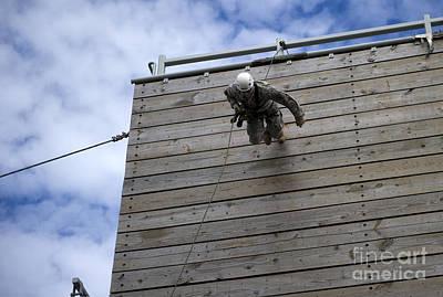 A U.s. Soldier Runs Down A 40-foot Print by Stocktrek Images
