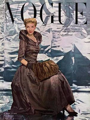 1940s Fashion Photograph - A Vogue Cover Of A Woman Wearing A Brown Dress by Erwin Blumenfeld