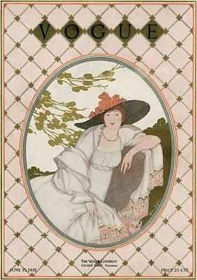 Vintage Hats Photograph - A Vogue Cover Of A Woman Wearing A Gray Dress by Helen Dryden