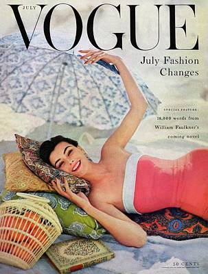 Swimsuit Photograph - A Vogue Cover Of Anne Gunning Under An Umbrella by Karen Radkai