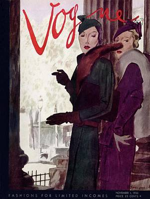 Photograph - A Vogue Cover Of Women Wearing Coats by Pierre Mourgue