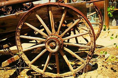 Wagon Wheels Photograph - A Wagon Wheel by Jeff Swan