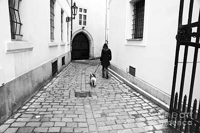 A Walk In Prague Art Print by John Rizzuto