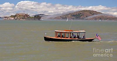 A Water Taxi Cruises Past Alcatraz Art Print by Jim Fitzpatrick