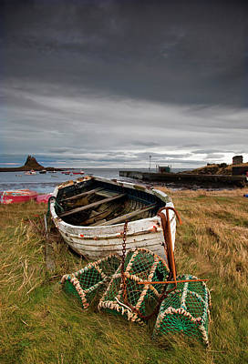 A Weathered Boat And Fishing Equipment Art Print by John Short