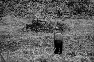 Tire Photograph - A Wet Tire by Robert Loe