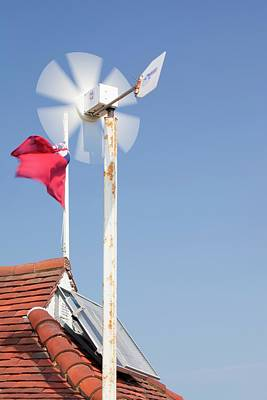 Flutter Photograph - A Wind Turbine On The Roof by Ashley Cooper