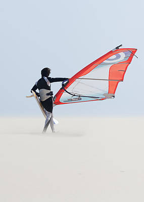 A Windsurfer Walks On The Sand Of Punta Art Print by Ben Welsh