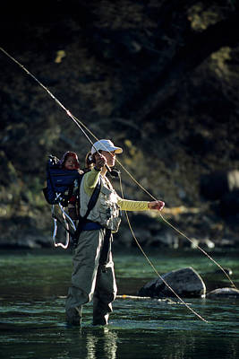 Colorado Fly Fishing River Wall Art - Photograph - A Woman And Her Son Fly Fishing by Kennan Harvey