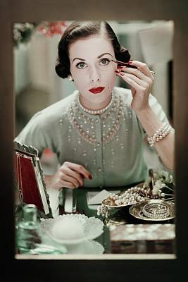 Eyeliner Photograph - A Woman Applying Make-up by Frances Mclaughlin-Gill