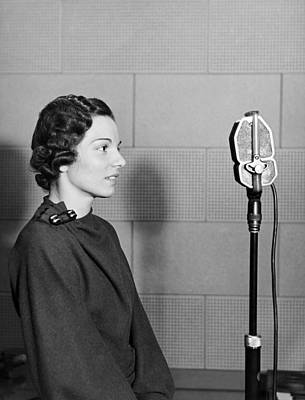 A Woman Broadcasting Art Print by Underwood Archives