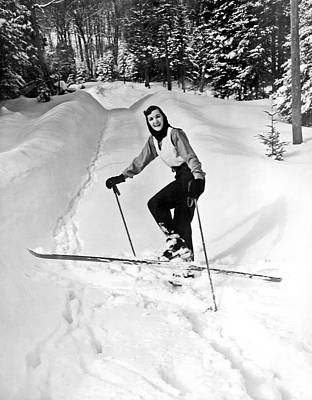 Cross Country Skiing Photograph - A Woman Cross Country Skiing by Underwood Archives