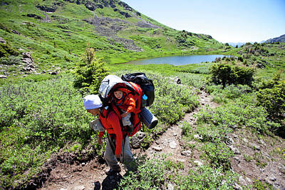 Landscape With Creek Photograph - A Woman Hikes Above Tree Line by Steve Glass