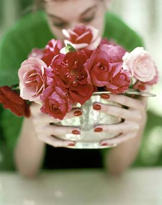 Indoors Photograph - A Woman Holding A Bowl Of Roses by John Rawlings