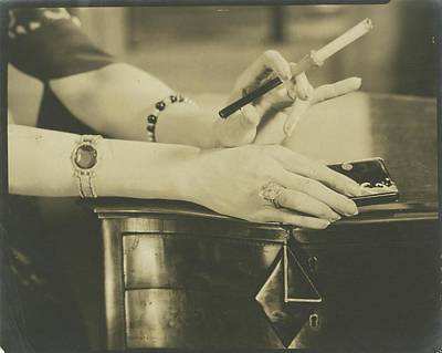 A Woman Holding A Cigarette Holder Art Print by Edward Steichen