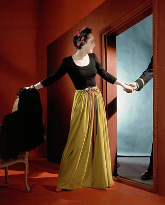 Two People Holding Hands Photograph - A Woman Holding The Hand Of A Man By A Doorway by Horst P. Horst