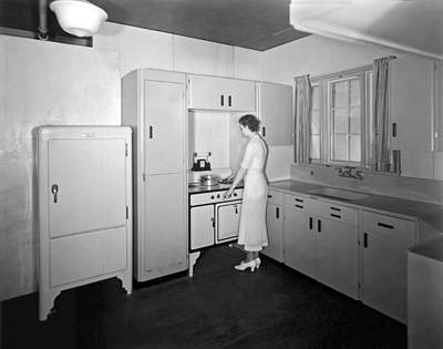 A Woman In Her Kitchen Print by Underwood Archives