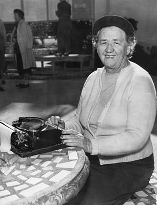 Typing Photograph - A Woman Journalist Typing by Underwood Archives