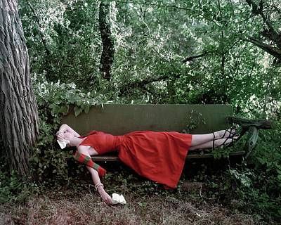Accessories Photograph - A Woman Lying On A Bench by John Rawlings