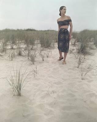 A Woman On A Beach Wearing An Off-the-shoulder Art Print