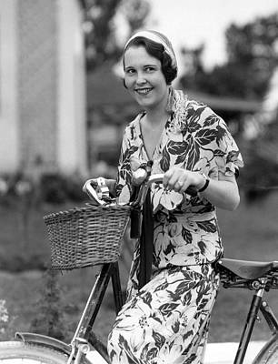 A Woman On A Bicycle Art Print by Underwood Archives