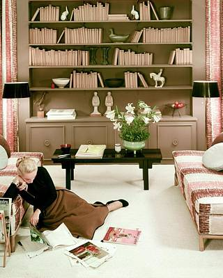 Table Photograph - A Woman Reading Magazines On The Floor by Haanel Cassidy