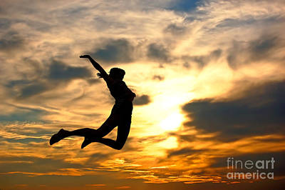 Backlit Photograph - A Woman Showing Her Happiness by Michal Bednarek