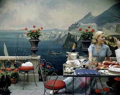 Sea Food Photograph - A Woman Sitting At A Dining Table In Front by John Rawlings