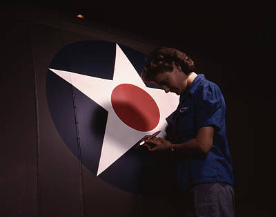 Insignia Painting - A Woman Touching Up The U.s. Army Air by Stocktrek Images