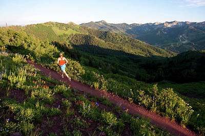 Big Cottonwood Canyon Photograph - A Woman  Trail Running On The Crest by Mike Schirf