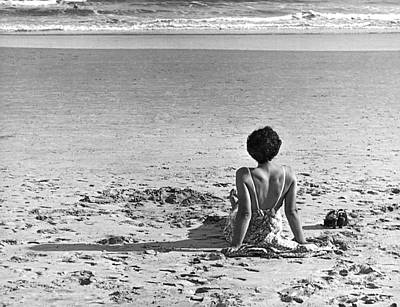 Beach Scenes Photograph - A Woman Wave Watching by Underwood Archives