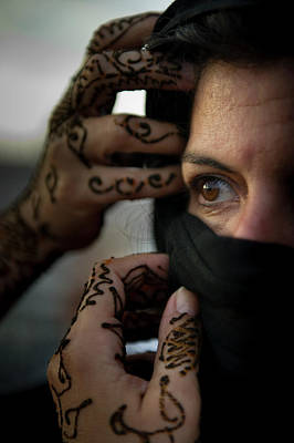 Henna Tattoo Photograph - A Woman With Henna Tattoos Adjusts by Stacy Pearsall