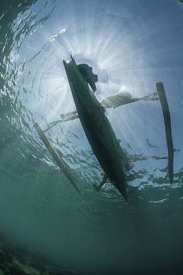 Images Of Ocean Canoes Photograph - A Wooden Outrigger Near A Remote Island by Ethan Daniels