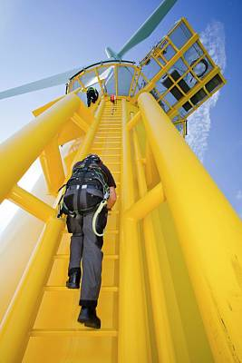 Climbing In Photograph - A Worker Climbs A Turbine by Ashley Cooper