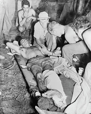 A Wounded American Soldier Gets A Blood Print by Stocktrek Images