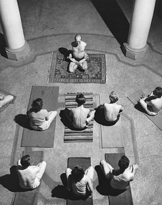 Wooden Floors Photograph - A Yoga Class In Session by Underwood Archives
