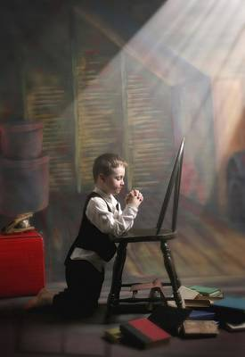 A Young Boy Praying With A Light Beam Art Print by Pete Stec