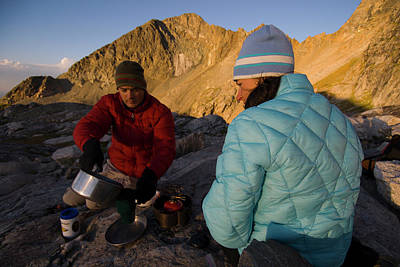 Hobbies And Collections - Art And Photograph - A Young Couple Makes Backcountry Coffee by Jeff Diener