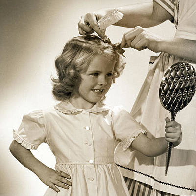 A Young Girl Gets A Bow Art Print by Underwood Archives