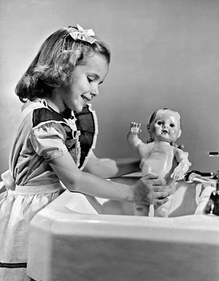 Imitation Photograph - A Young Girl Plays With Her New All-vinyl Plastic Doll That Can by Underwood Archives