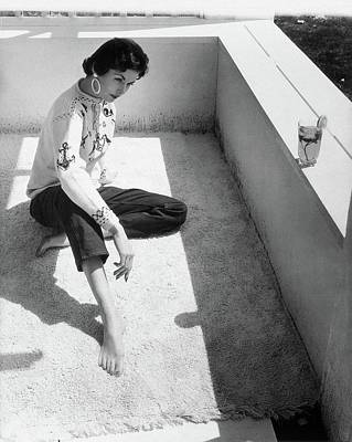 Photograph - A Young Model Crouching On A Porch by Horst P. Horst