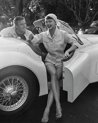 A Young Model Sitting In A Convertible Sports Car Art Print by Karen Radkai