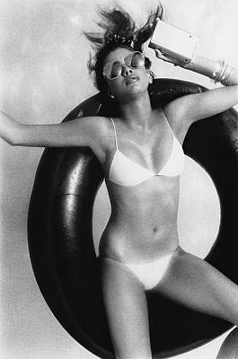 Fashion Photograph - Debbie Dickinson Floating On An Inner Tube by Albert Watson