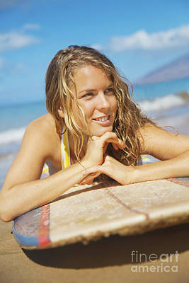 A Young Woman Lays On A Surfboard On The Sand_ Maui, Hawaii, United States Of America Art Print