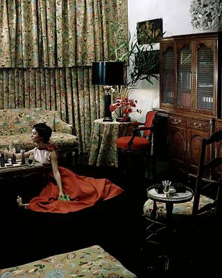 Board Game Photograph - A Young Woman Sitting On The Floor In The Living by Horst P. Horst
