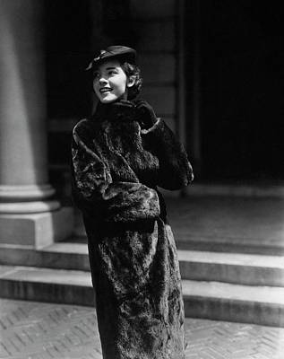 Photograph - A Young Woman Wearing A Fur Coat by Lusha Nelson