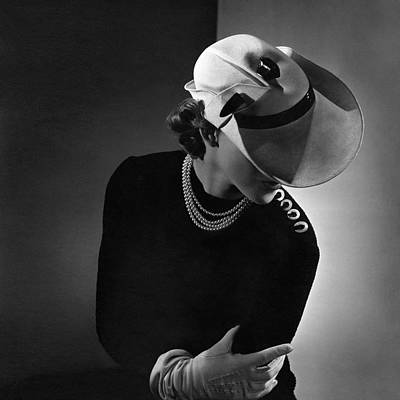 Photograph - A Young Woman Wearing A White Hat And A Pearl by Horst P. Horst