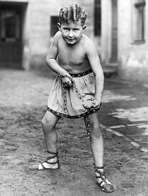 Black Curly Hair Photograph - A Youthfull Strongman by Underwood Archives